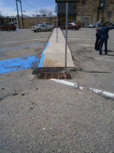 The existing storm grate before we installed the landscaping would have been easily plugged by floating mulch